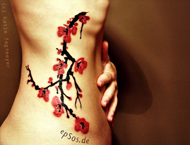 Best idea of female tree flowers tattoo designs for women.