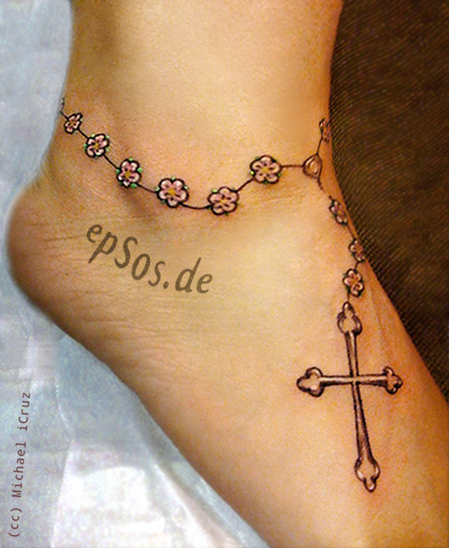 Best foot designs with cross tattoo for women.