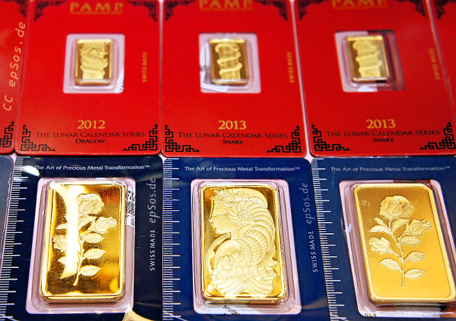 Golden bullion bars in the gold shop.