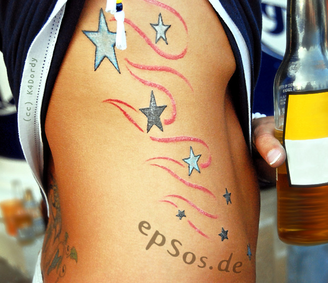 Best idea for the stars tattoo designs for women on the side.