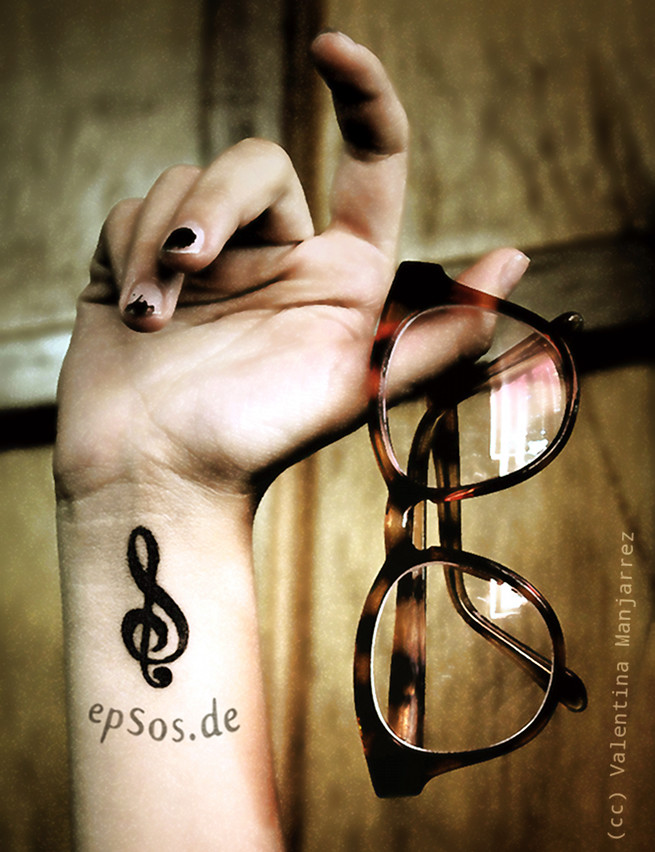 Best idea for the small wrist tattoo designs for women with music.